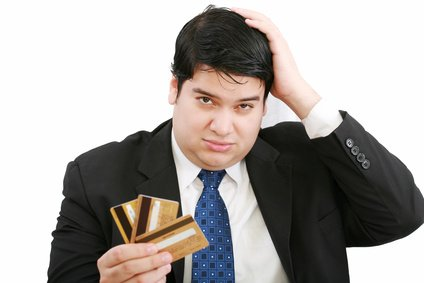 man holding out credit cards