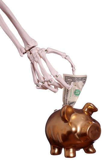 skeleton hand and piggy bank