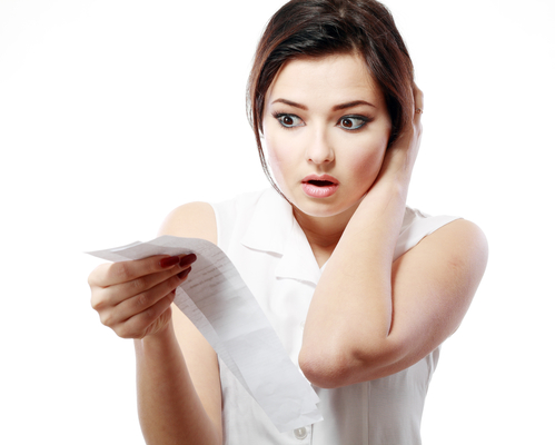 woman looking at receipt