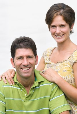 Man and woman facing camera enjoying debt relief