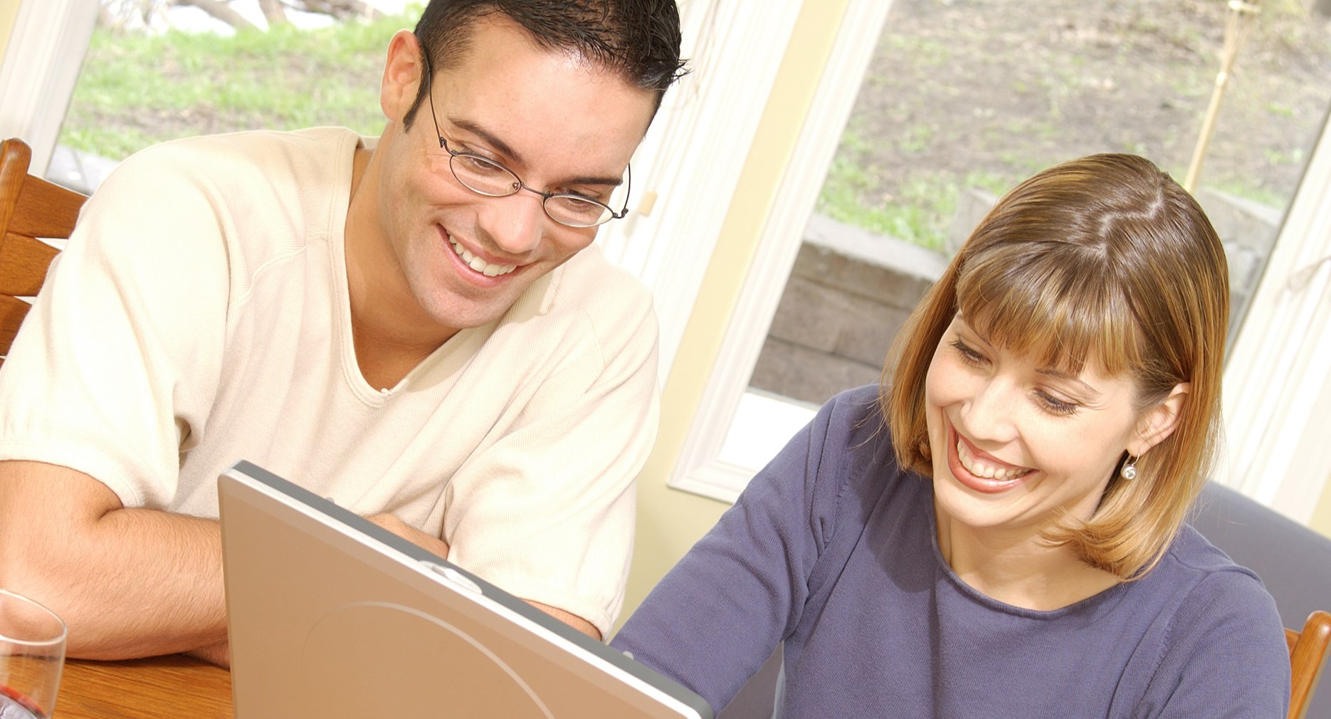 Young smiling couple with laptop