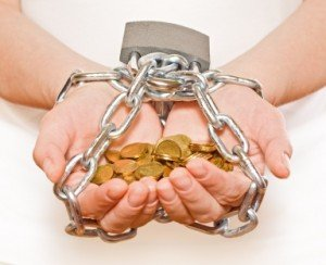 hands chained while holding coins