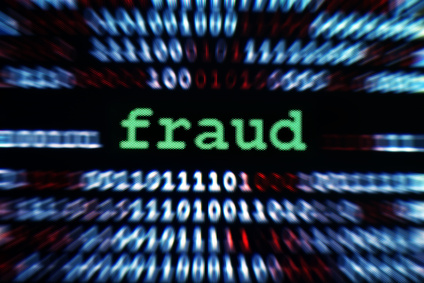 The word fraud surrounded by ones and zeros